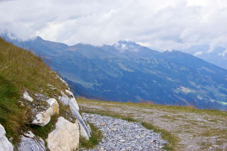 foot path: Foot path in a mountainous landscape a cloudy day in Austria