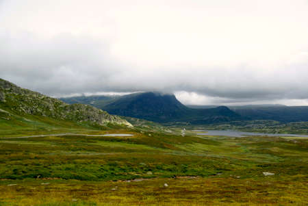 mountainous: Mountainous landscape with gray clouds in Norway