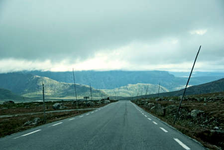 mountainous: Mountainous landscape with country road  in Norway