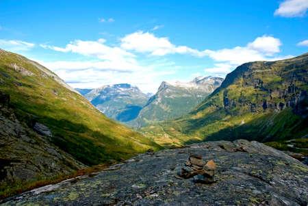 mountainous: Mountainous landscape with stones in foreground