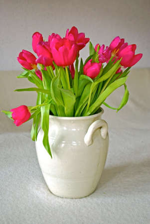 stoneware: Bouquet with pink tulips in a stoneware pot