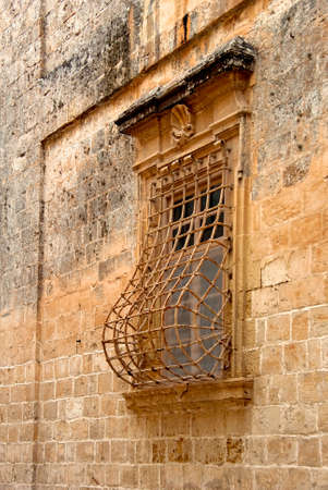latticework: Building with ornamented window with latticework