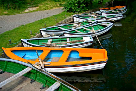waters  edge: Rowing boats lies on a line at the waters edge