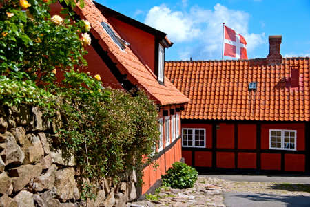 Buildings and a danish flag in Denmark  Stock Photo