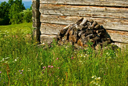 woodpile: Swedish timber barn with woodpile and wild flowers