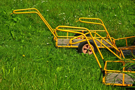 Luggage carts standing in the grass for lending  Stock Photo - 24834530