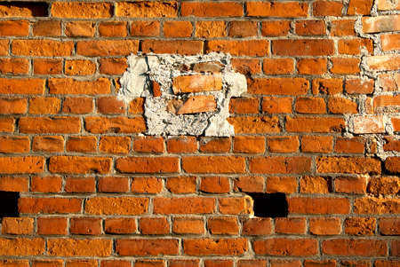 Old brick wall with added pieces  photo
