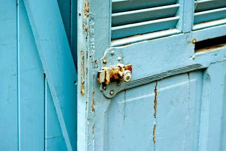 locking: Blue jalousie door with locking device  Stock Photo