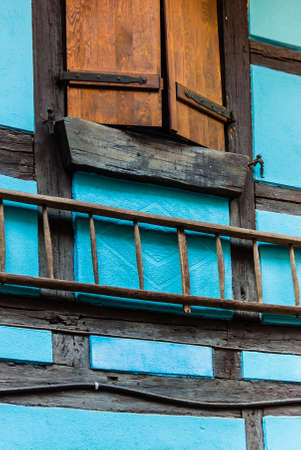 half  timbered: Shutter and ladder on half timbered building wall