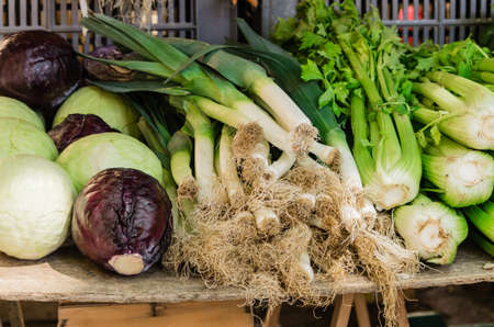 Fresh healthy vegetables as cabbage, leek and stalk celery for sale at farmers market in summer.