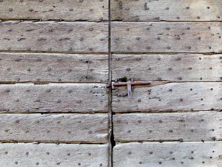 Wooden background with iron studs old doorway Standard-Bild
