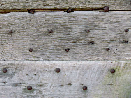 studs: Wooden background with iron studs