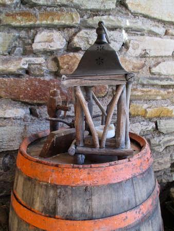 old wooden wine barrel with lantern Standard-Bild