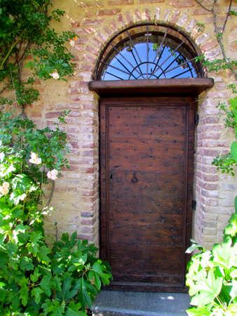 old wooden door with iron studs Standard-Bild