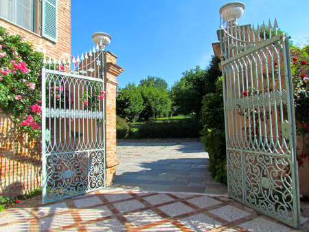 Welcoming open historical and elegant gate Standard-Bild