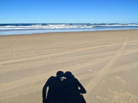 Fraser Island, couple kissing shadow