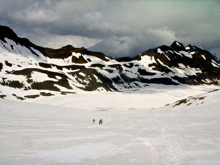 Mountains alps snow people walking on glacier