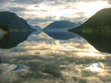 Norwegian fjords with clouds reflection in water Standard-Bild