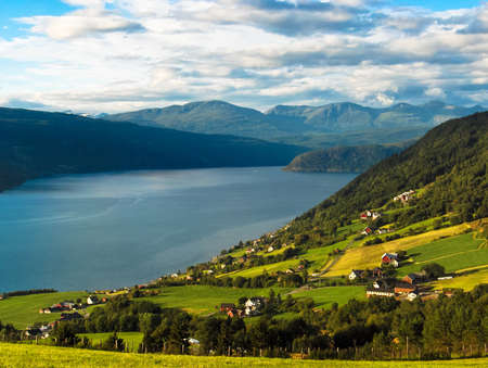 Meadows and village on norvegian fjords