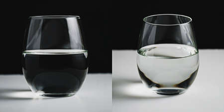 Concept picture of a glass half filled with water. Comparison of two points of view - philosophy of seeing both good and bad in same object or situation.