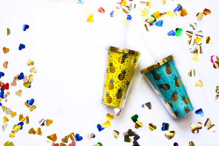 Bright tumblers with a pineapple print on the white background.