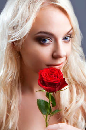 Beautiful girl with red rose in her blond hair  roses Stock Photo