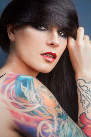 Beautiful girl with stylish make-up and tattooed arms  tattoo Stock Photo