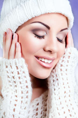 attractive young caucasian woman in warm clothing  white cloth Stock Photo - 15874505