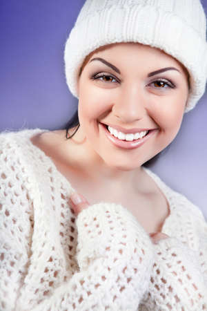 attractive young caucasian woman in warm clothing  white Stock Photo - 15874506