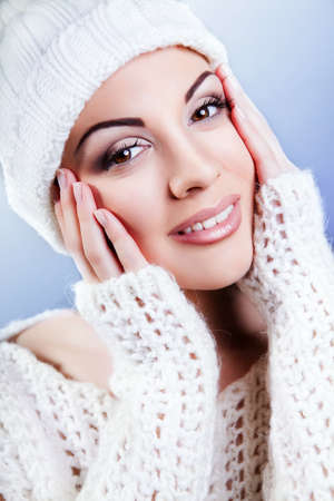 attractive young caucasian woman in warm clothing  white photo