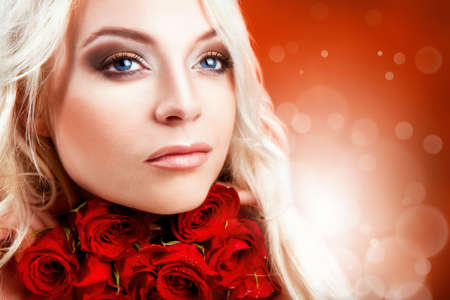 Beautiful girl with red roses in her blond hair   red roses Stock Photo - 15874586
