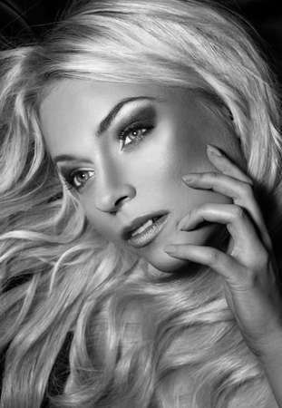 black and white portrait of young beautiful woman with long blond hair  blond Stock Photo - 15874588