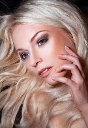 Young beautiful blond woman with stylish make-up  blond  Stock Photo - 15874589
