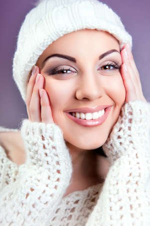 attractive young caucasian woman in warm clothing  white cloth Stock Photo