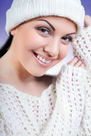 attractive young caucasian woman in warm clothing. white cloth