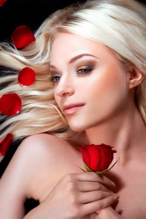 Beautiful girl with red roses in her blond hair. roses Stock Photo