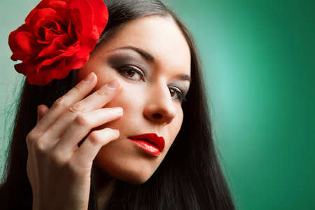 portrait of beautiful woman with red rose. rose