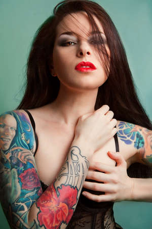 Beautiful girl with stylish make-up and tattooed arms. Stock Photo - 16143436