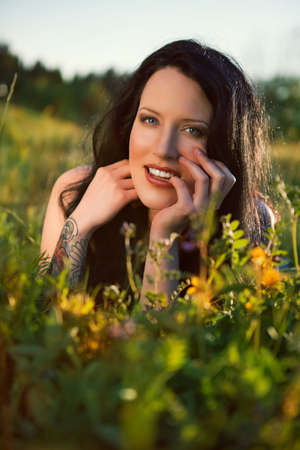 beautiful girl on green field Stock Photo - 16143444