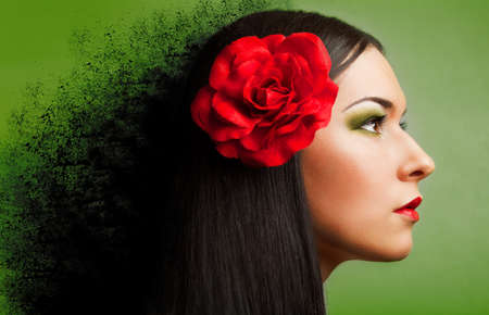 portrait of beautiful woman with red rose. black splash. Stock Photo