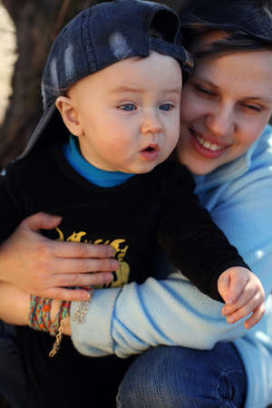Mother with baby at outdoors. boy. Stock Photo