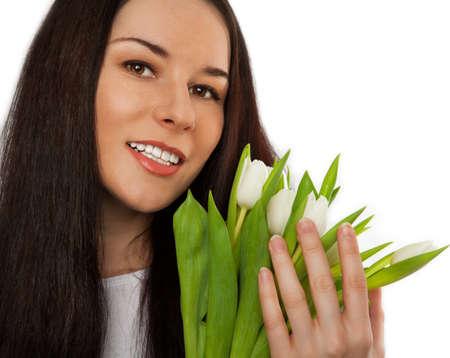 Beautiful girl holding bouquet of white tulips. Stock Photo - 16143427