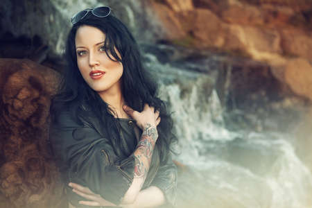Portrait of beautiful woman with tattoo. outdoors