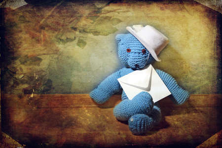 Teddy bear with an envelope. vintage background Stock Photo