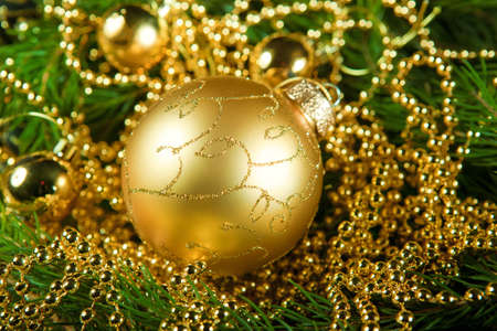 gold christmas ball. tree.