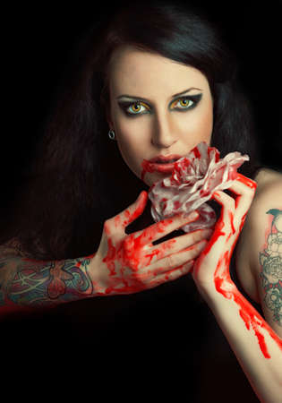 portrait of beautiful gothic girl with rose and blood Stock Photo - 16143621