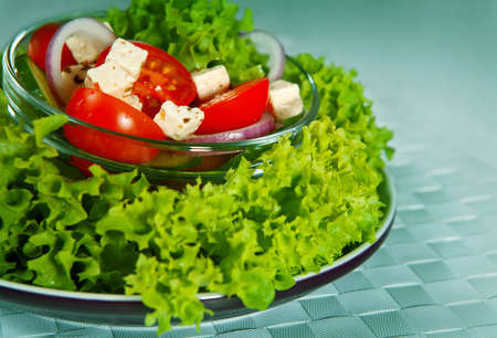 salad with vegetables and greens. background