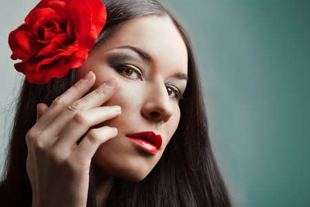 portrait of beautiful woman with red rose photo