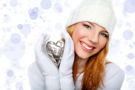Smiling girl holding valentine heart  isolated on sparkling background