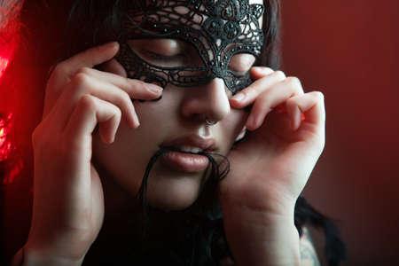 cute girl in masquerade mask Stock Photo